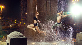Attractiveain athletes jumping in the fountain royalty free stock images