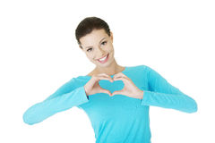 Attractiveyoung woman showing heart gesture Stock Photo