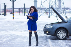 Attracts the attention of a woman reading a manual car. Attracts the attention of a beautiful woman reading a manual car Stock Photography