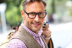 Attractve man with eyeglasses walking in street Royalty Free Stock Photo