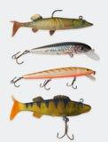 Attraits colorés de pêche au-dessus de blanc Photos stock