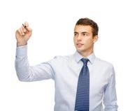 Attraktiv buisnessman eller lärare med markören arkivfoton