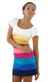Attraktiv etnisk flicka i nätt klänning fotografering för bildbyråer