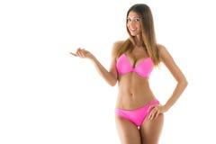 Attraktiv flicka i en bikini Arkivfoton