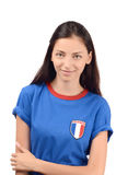 Attraktiv flicka med den Frankrike flaggan på hennes blåa t-skjorta Royaltyfri Bild