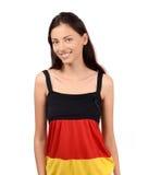 Attraktiv flicka med Tysklandflaggablusen. Arkivfoton
