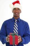 attraktiv gåva som ger mannen Arkivfoto