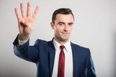 Attraktiv gest för nummer fyra för visning för affärsman Royaltyfri Bild