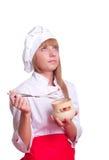 Attraktiv kockkvinna a över vitbakgrund Arkivbilder