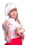 Attraktiv kockkvinna a över vitbakgrund Royaltyfri Foto