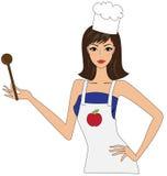 attraktiv kockkvinnlig Arkivfoto