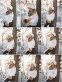 Attraktiv kvinna med det vita pälslocket och omslaget som tycker om vintern Sidosikt av trendigt blont posera för flicka fotografering för bildbyråer