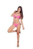 Attraktiv kvinna med rosa swimwear Arkivbild