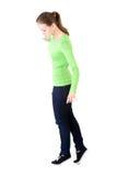 Attraktiv kvinna som ner står och ser, rörande kopieringsutrymme. Royaltyfria Foton