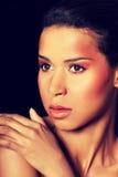 Attraktiv kvinnas framsida med smink Royaltyfria Foton