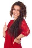 Attraktiv kvinnlig med tummar-upp och reko gest royaltyfria foton