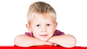 Attraktiv le pojke som isoleras på vit backgroun Royaltyfria Foton