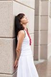 Attraktiv ledsen flicka med röda pärlor Royaltyfri Bild