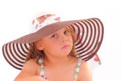 Attraktiv liten flicka i en hatt Arkivfoton