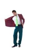 Attraktiv man som poserar i knäppt upp omslag Arkivfoto