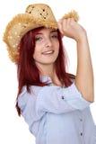 Attraktiv redheadflicka med sugrörhatten som isoleras Arkivbild