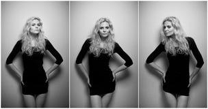 Attraktiv sexig blondin i den svarta korta åtsittande passformklänningen som provocatively inomhus poserar sinnlig kvinna för stå Royaltyfri Foto