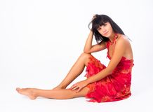 Attraktiv sittande flicka Royaltyfria Foton