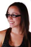 Attraktiv ung kvinna i exponeringsglas Arkivfoton