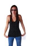 Attraktiv ung kvinna i exponeringsglas Arkivfoto