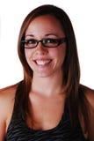 Attraktiv ung kvinna i exponeringsglas Arkivbilder