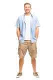 Attraktiv ung man som ler full längd på vit bakgrund Royaltyfria Foton