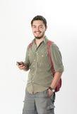 Attraktiv ung man som lyssnar till hörlurar Arkivfoto