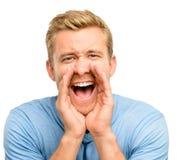 Attraktiv ung man som ropar - som isoleras på vit bakgrund Royaltyfria Foton