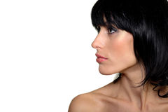 attraktiv vänster seende makeupståendekvinna Arkivbilder