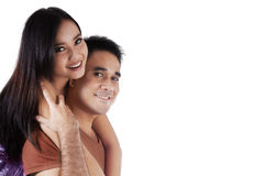 Attraktiva asiatiska par i studio Royaltyfria Foton
