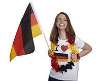 Attraktiva fanleenden och tysk flagga arkivbilder