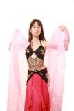 attraktiva magdansdansaredanser klär den östliga flickaorangen Royaltyfria Bilder