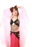 attraktiva magdansdansaredanser klär den östliga flickaorangen Royaltyfri Foto