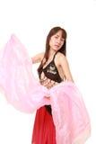 attraktiva magdansdansaredanser klär den östliga flickaorangen Arkivfoton