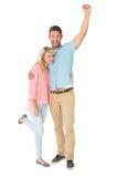 Attraktiva par som ler och hurrar Arkivbilder