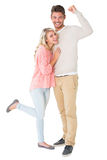 Attraktiva par som ler och hurrar Arkivfoton