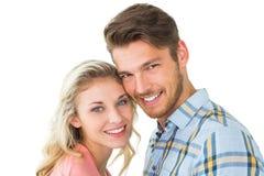 Attraktiva par som ler på kameran Arkivbilder