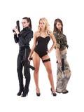 attraktiva trycksprutor tre unga kvinnor Royaltyfri Foto