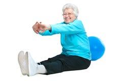 Attraktive ältere Frau am Gesundheitsklumpen Lizenzfreie Stockfotografie