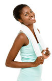 Attraktive Afroamerikanerfrau, die Turnhallentuch-Weiß backgr hält Stockbild