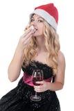 Attraktive blonde Frau, die Kuchen isst Stockbild