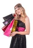 Attraktive blonde Frau mit Einkaufstaschen Stockfotos