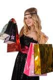 Attraktive blonde Frau mit Einkaufstaschen Lizenzfreie Stockbilder