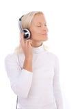 Attraktive blonde hörende Musik Stockbilder