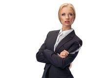Attraktive blonde tragende Gläser der Geschäftsfrau Stockfotos